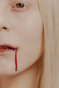 vampire with blood on lip